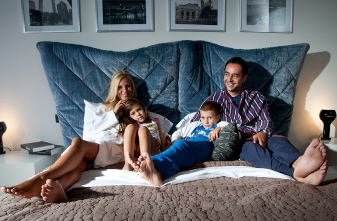 family laughing in bed